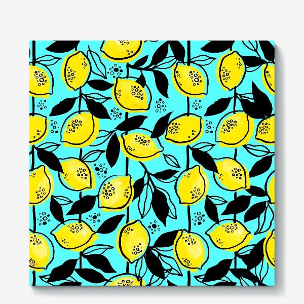 Холст «Жёлтые лимоны с черными листьями на голубом фоне»