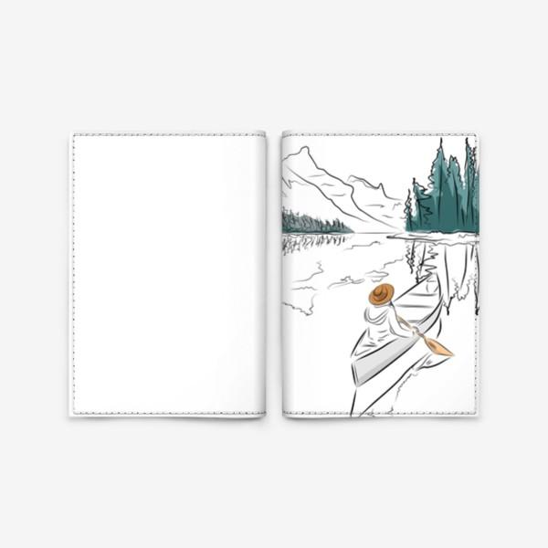 Обложка для паспорта «Девушка в шляпе в лодке каноэ плывет по озеру в горах среди ёлок»