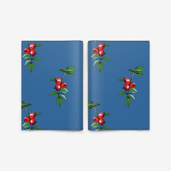 Обложка для паспорта «Красные ягоды шиповника на синем фоне. Яркие плоды на ветке с зелеными листьями»